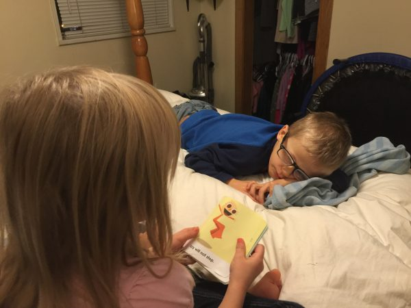 Max had to come home early from school because he wasn't feeling well, and Sydney decided to read to him while he laid in bed.